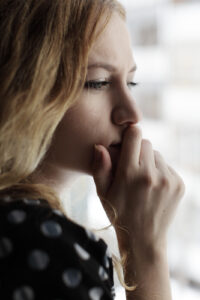 Woman looking off into window, close up on face. She is struggling to come to terms with a recent loss. Counselor at Whole Journey understand that grief and loss is a process. With counseling in Virginia, you can work through emotions and moving toward healing. Begin grief and loss counseling with us soon.