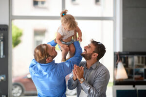 Happy male same sex couple playing with daughter. If you're looking for family therapy or child counseling with an LGBTQIA+ friend therapist, you've come to the right place. Begin LGBTQIA+ counseling in North Carolina or Virginia today!
